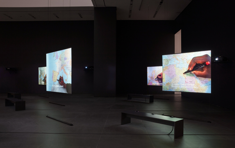 """The Mapping Journey Project"". 2008–11. Eight-channel video (color, sound). Installation view, solo exhibition, ""Bouchra Khalili: The Mapping Journey Project"", The Museum of Modern Art, New York, April 9–October 10, 2016. Photo: Jonathan Muzikar"